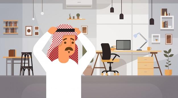 Arab business man holding head problem concept entrepreneur in modern office