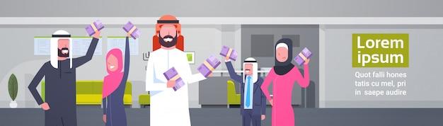 Arab business people group holding stacks of money euro businesspeople muslim team of winner finance success concept horizontal illustration