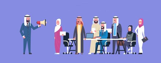 Arab businessman boss hold megaphone make announcement colleagues islam business people team group meeting
