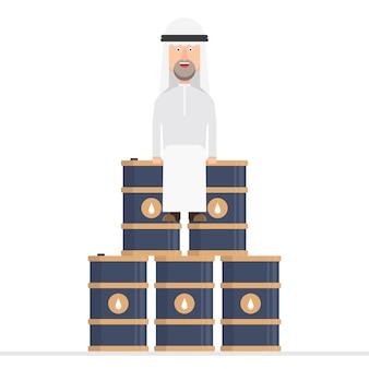 アラブのビジネスマンが石油バレルに座っています。