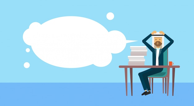 Arab businessman sitting at office desk hold the head bubbles business man hard working process concept banner