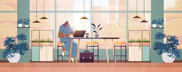 Arab businessman sitting at workplace arabic business man freelancer working in creative office horizontal full length vector illustration