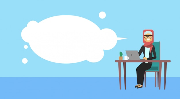 Arab businesswoman sitting at office desk hold laptop bubbles business woman hard working process concept banner