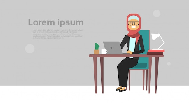 Arab businesswoman sitting at office desk hold laptop business woman hard working process concept banner