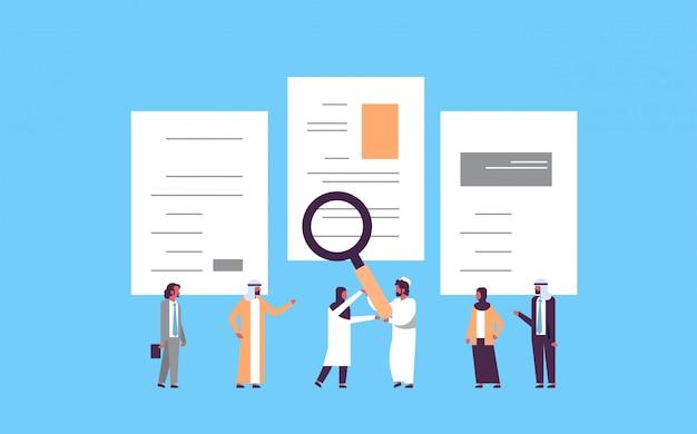Arab man hand hold magnifying zoom cv resume arabic team