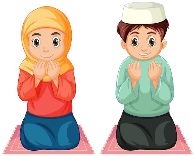 Арабские мусульманские мальчик и девочка в традиционной одежде молятся сидя, изолированные на белом фоне