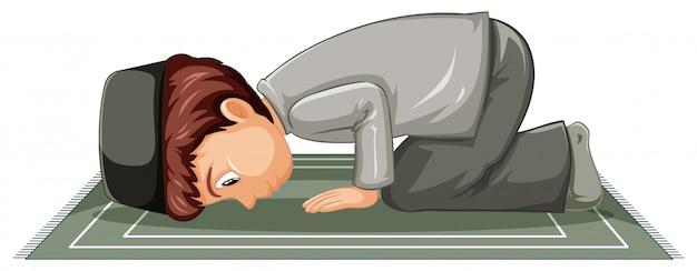 Арабский мусульманский мальчик в традиционной одежде в молитве позиции на белом фоне