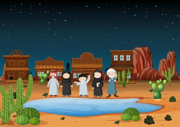 Арабские люди, стоящие на пустынной земле ночью