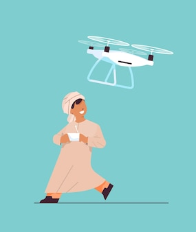 Arab schoolboy controlling air drone with wireless remote controller smiling boy having fun full length vertical vector illustration