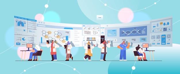 Arab scientists team analyzing medical data on virtual board medicine healthcare concept