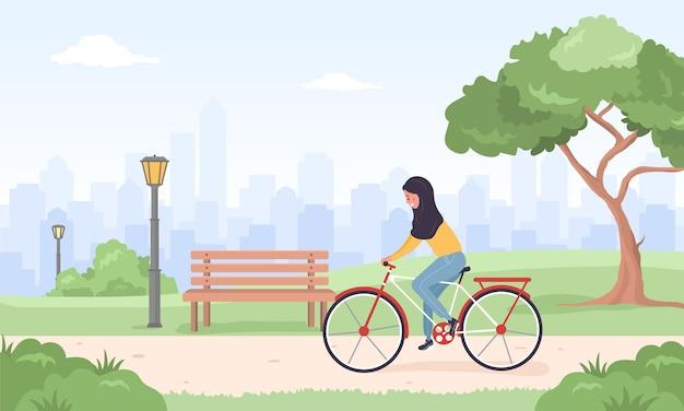 자전거에 히잡에서 아랍 여성은 도시 주변을 탄다. 봄 또는 여름 풍경.