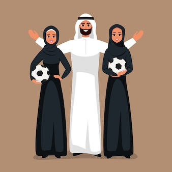 Arab young women and arabian man standing together with soccer ball in the hands