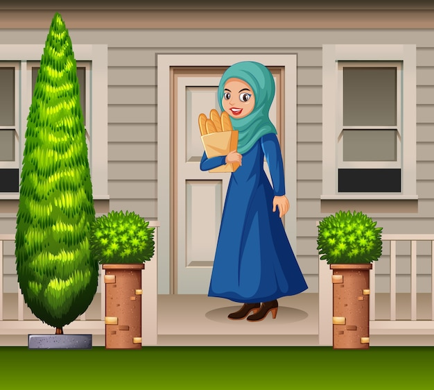 Arabian woman in front of the house