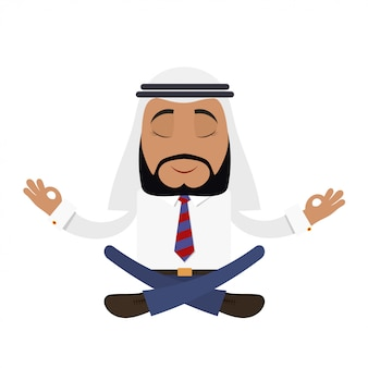 Arabic businessman in the lotus position.  financial yoga.  young man in traditional arab hat. concept of a successful arab businessman