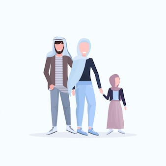 Arabic father mother and little daughter walking together happy arab family in traditional clothes having fun  white background full length