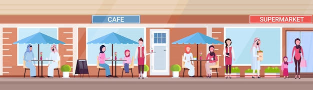 Arabic people visitors sitting summer cafe shop arab customers holding purchases in front of supermarket exterior urban street concept horizontal banner full length