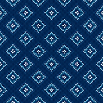 Argyle knitting pattern. seamless wool knit texture with shades of blue colors.