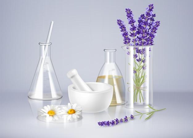유리 제품 모르타르와 신선한 라벤더, 카모마일 꽃을 사용한 아로마테라피 현실적인 구성