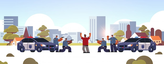 Arrested criminal character with raised arms robber caught by police officers theft security authority justice law service concept cityscape background full length horizontal