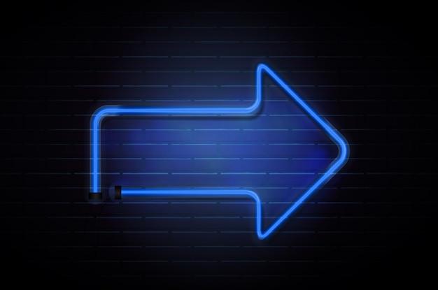 Стрелка светящиеся неоновые синие трубки на фоне темной кирпичной стены