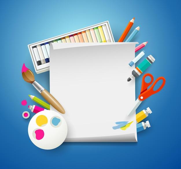 Принадлежности для рисования и пустая белая бумага.