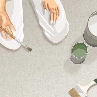 그녀의 손 디자인 공간에서 붓으로 무릎을 꿇고 있는 예술가