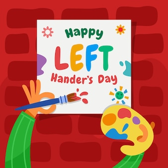 Artist make lettering art to celebrate left handers day.
