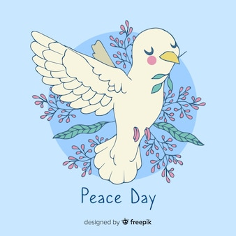 Artistic hand drawn peace day dove