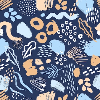 Artistic seamless pattern with abstract leaves, paint smudges, brush strokes on blue background.