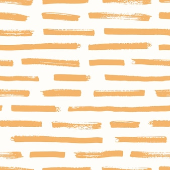 Artistic seamless pattern with orange brush strokes on white background. decorative backdrop with rough horizontal paint traces. creative vector illustration in contemporary art style for wallpaper.