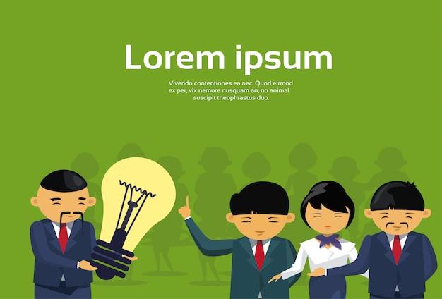 Asian business man leader giving light bulb