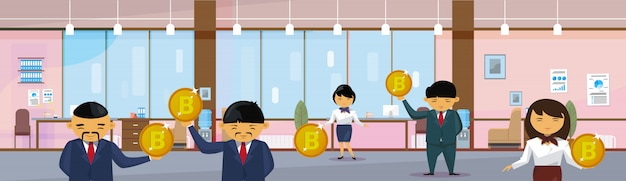 Asian business people group holding bitcoins coins