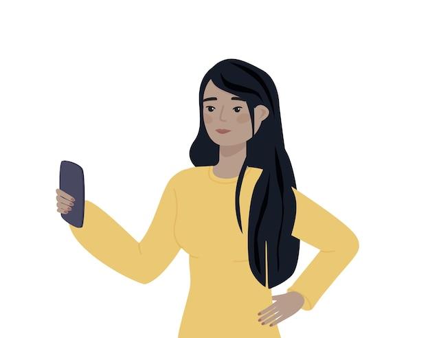白い背景の上の携帯電話を持つアジアのキャラクタースマートフォンを保持している女性