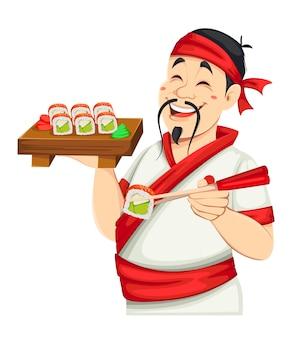 Азиатский повар держит суши красивый японский повар