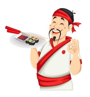 Азиатский шеф-повар, держащий суши. красивый японский повар