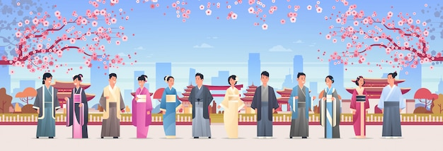 Asian people group in traditional clothes men women wearing ancient costumes standing together chinese or japanese characters over pagoda buildings landscape