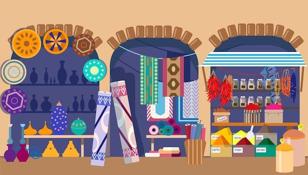 陶器のカーペットやスパイスの店があるアジアのストリートバザール