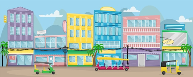 Asian street with colorful buildings, electric wires and tuk tuks on the roads.