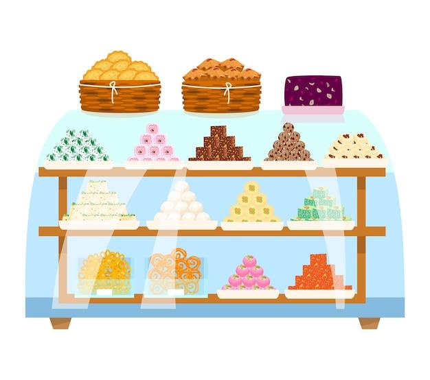 Азиатские сладости в пирамидах и контейнерах внутри стеклянной витрины