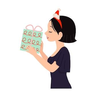 クリスマスプレゼントを持っているアジアの女性