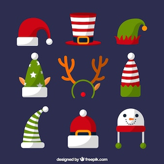 Assortment of christmas hats in flat design