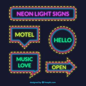 Assortment of neon lights signs with yellow details