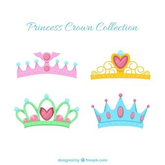 Assortment of decorative princess crowns in flat design
