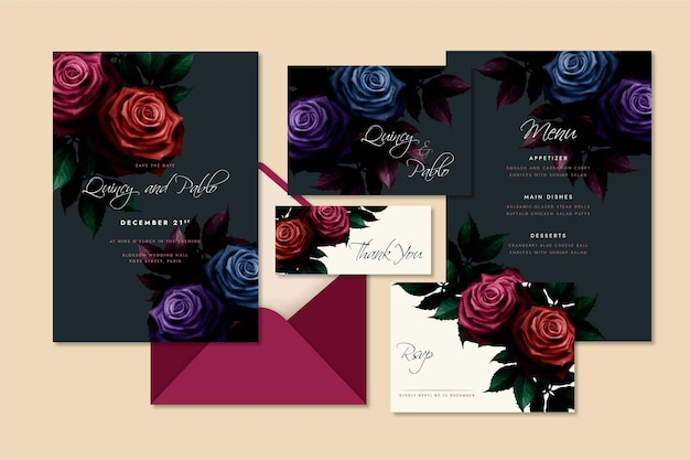 Assortment of watercolor dramatic botanical wedding stationery