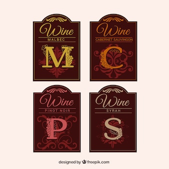 Assortment of wine labels with decorative letters