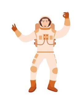白い背景の上のオーケーを身振りで示す宇宙服の宇宙飛行士