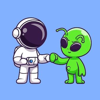 かわいいエイリアンの友人漫画ベクトルアイコンイラストと宇宙飛行士。科学技術アイコンコンセプト分離プレミアムベクトル。フラット漫画スタイル