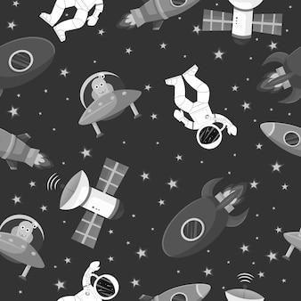ロケットとエイリアンのシームレスなパターンを持つ宇宙飛行士