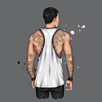Спортивный парень в футболке и с татуировками.