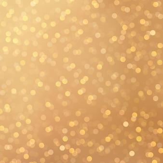 ボケ光の効果を持つ魅力的な金色の背景